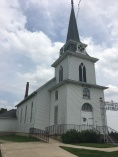 Springdale Lutheran Church whith the steeple attributet to Aslak Olsen Lie and built in 1877.