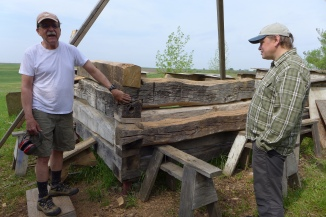 Nels Deller (left) and the new rising of the Aslak Lie house at Folklore Village.